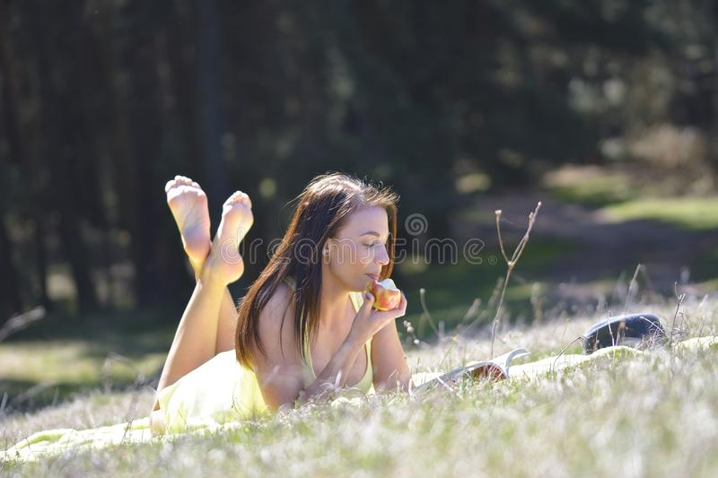 Beautiful girl with book in the spring park. Beautiful girl with book in the spring park stock photography
