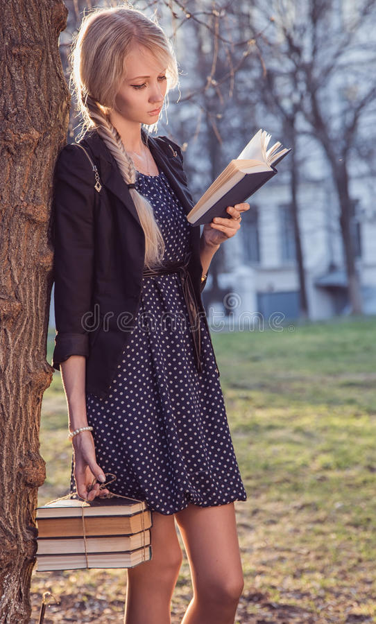 Beautiful girl with books royalty free stock images