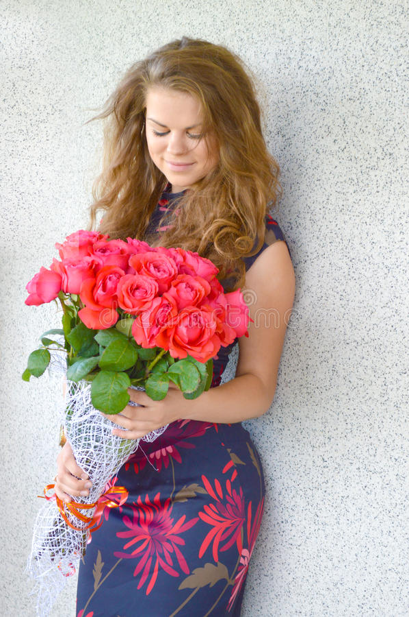 Beautiful girl with a bouquet of roses stock images