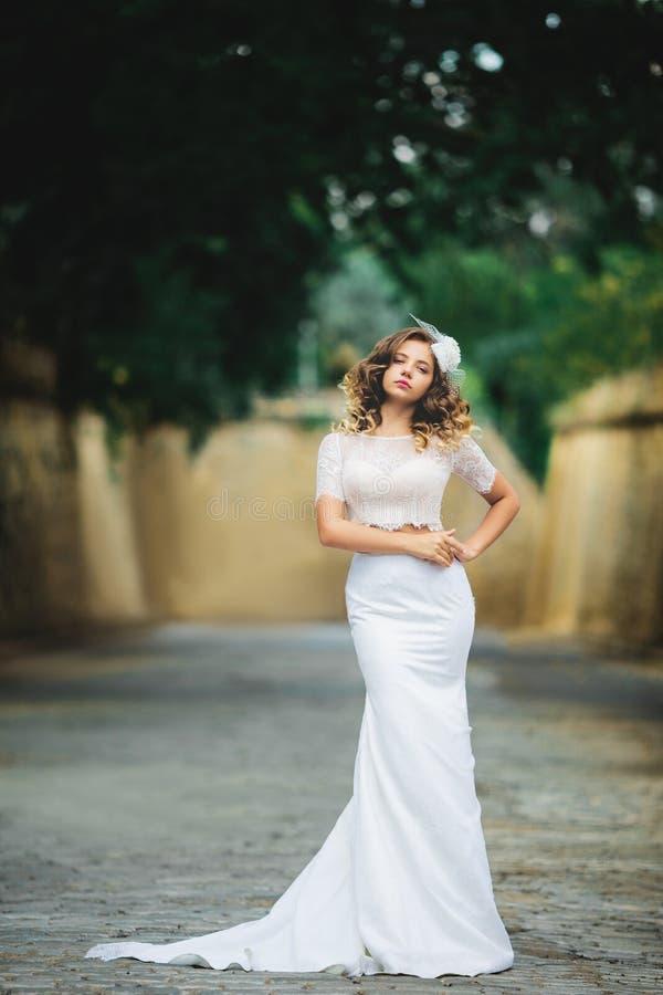 Beautiful girl bride in designer dress royalty free stock image