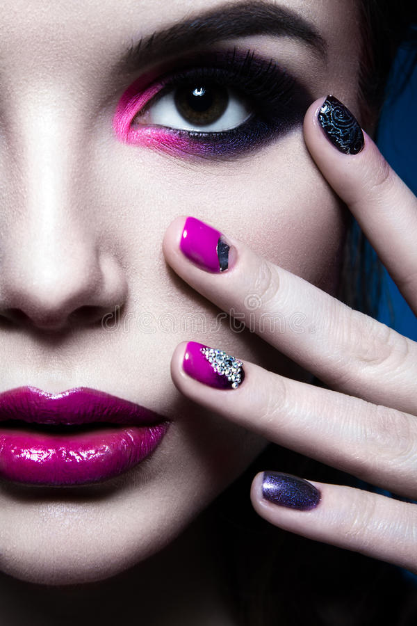 Beautiful girl with bright creative fashion makeup. And colorful nail polish. Art beauty design. Beauty face. Studio portrait royalty free stock image