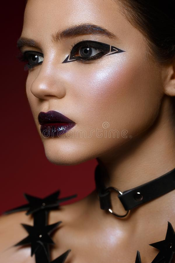 Beautiful girl with bright creative make-up and graphic arrows. Beauty face. stock image
