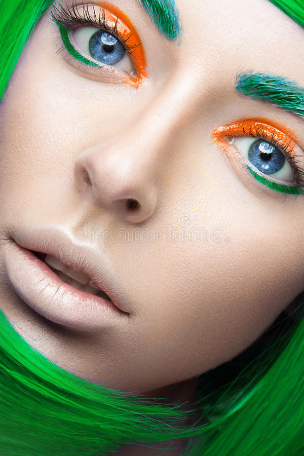 Beautiful girl in a bright green wig in the style of cosplay and creative makeup. Beauty face. Art image. Picture taken in the studio royalty free stock photos