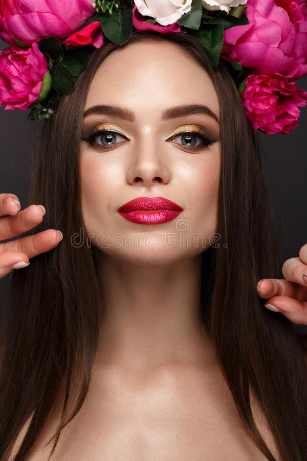 Beautiful girl with bright make-up and flowers on her head. Beauty face. stock images