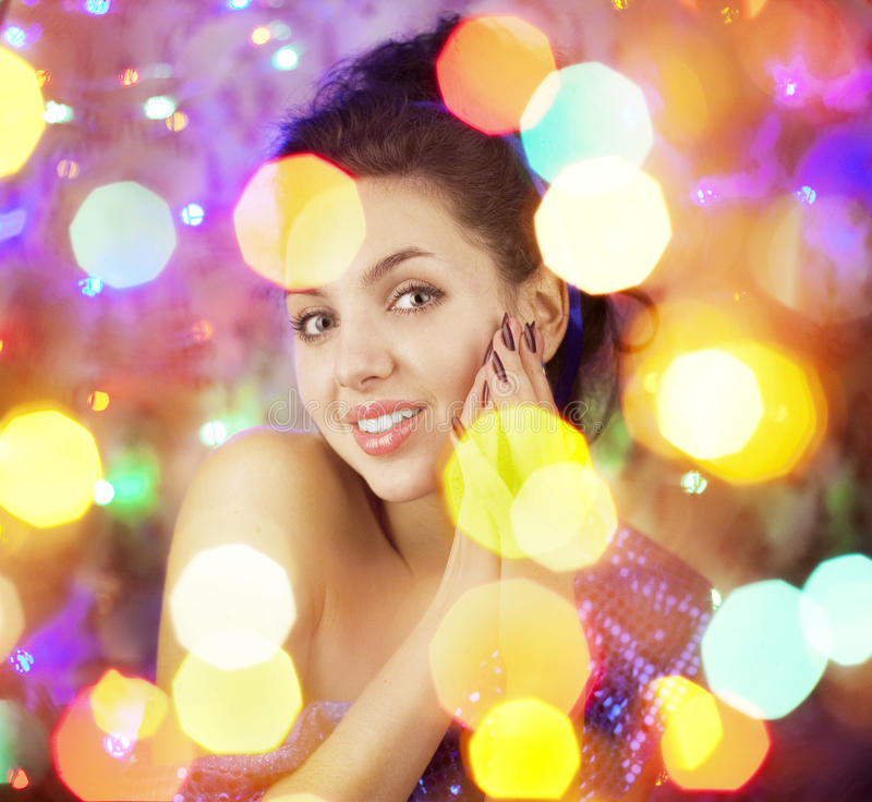 Beautiful girl in the bright night lights. Images of a beautiful girl in the bright night lights royalty free stock images