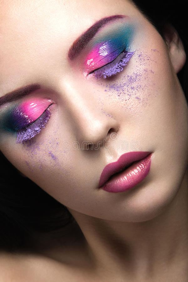 Beautiful girl with bright pink make-up and perfect skin. Beauty face. Festive image. royalty free stock photos