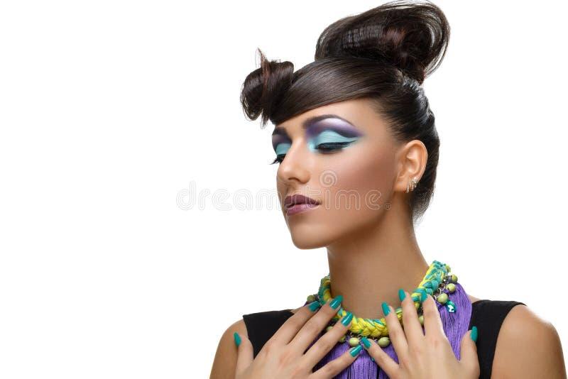 Beautiful girl with bright vivid purple make-up royalty free stock photo