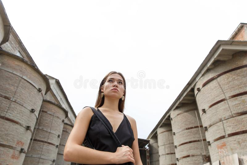Pretty girl posing at factory where concrete is cast stock photos