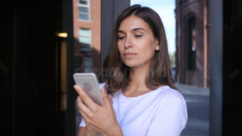 Beautiful Girl Browsing on Smartphone, Using Phone stock photos