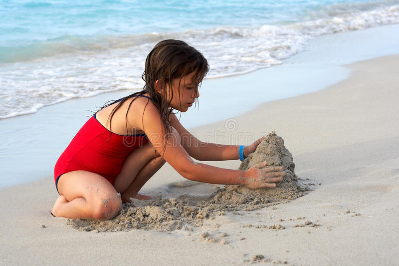 Download Beautiful Girl Building A Sand Castle In The Beach Stock Photo - Image: 11168714