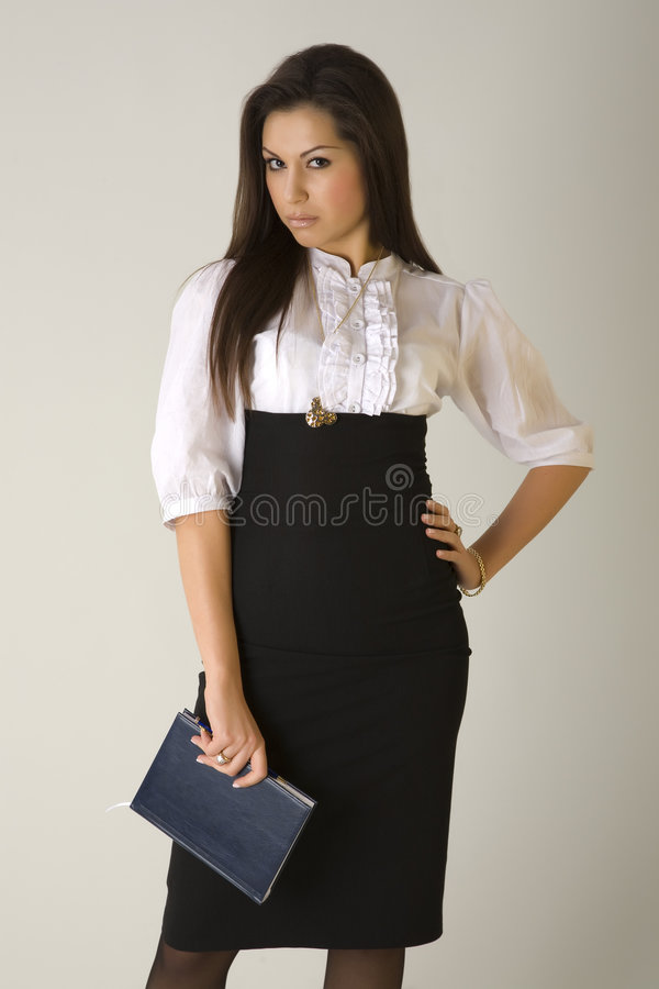 Beautiful girl in business outfit holding agenda
