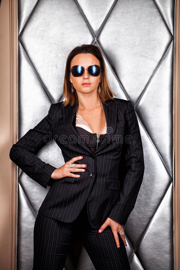 Beautiful girl in a business suit stock photography