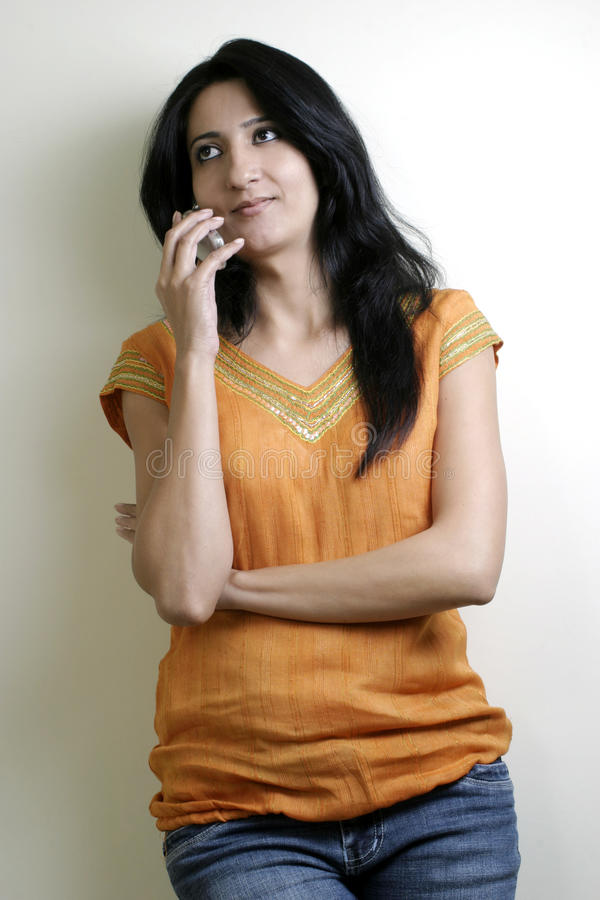 Download Beautiful Girl Busy Talking On Mobile Phone Stock Photo - Image of phone, relaxed: 23553252
