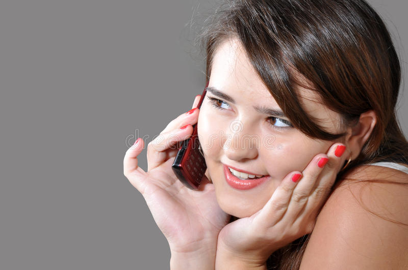 Beautiful girl calling by mobile