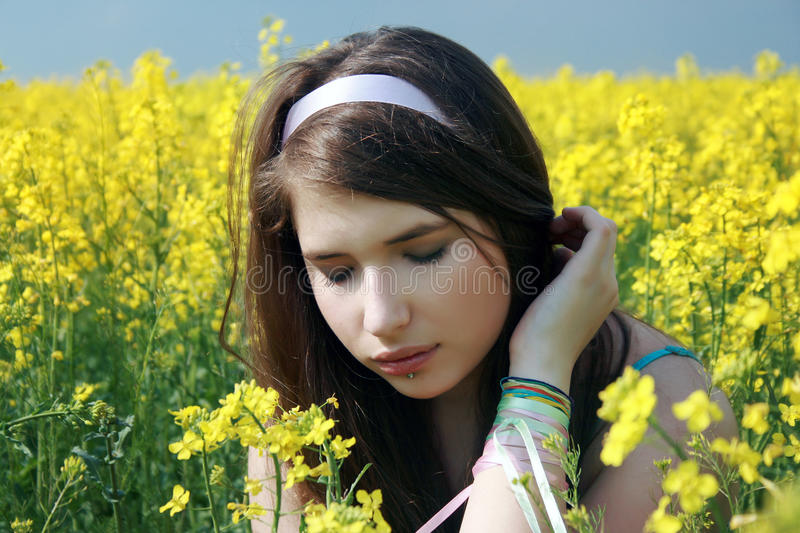 Download Beautiful girl at canola stock photo. Image of flowers - 10565164