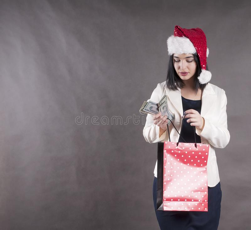 Beautiful girl cap santa gift package money stock photos