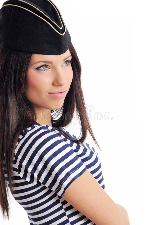 Beautiful girl in captain's hat stock photography
