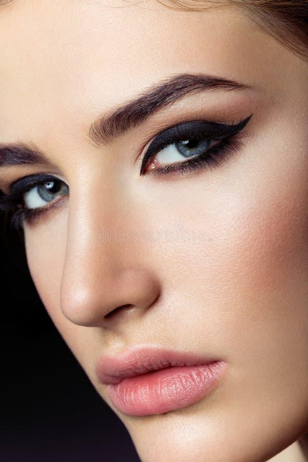 Beautiful girl with cat eye make-up royalty free stock photo