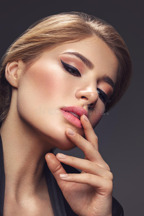 Beautiful girl with cat eye make-up stock photo