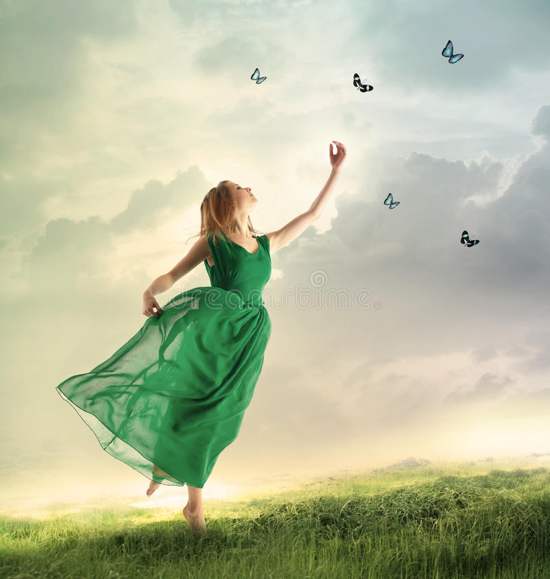 Free Beautiful Girl Catching Butterflies On A Mountain Stock Images - 48070374