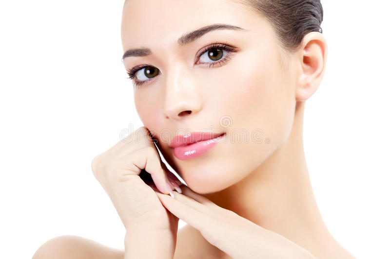 Beautiful girl. With clean fresh skin, white background royalty free stock photography