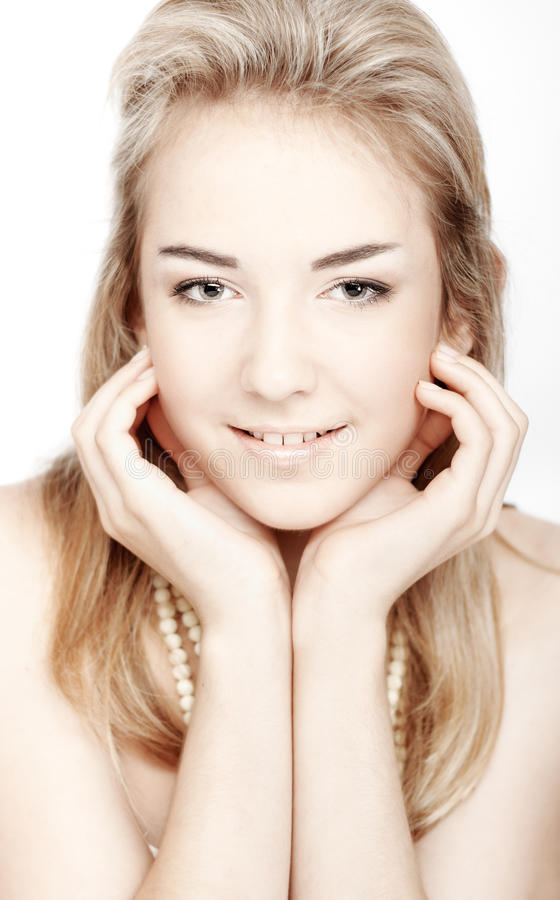 Beautiful girl with clean skin of the face stock photography