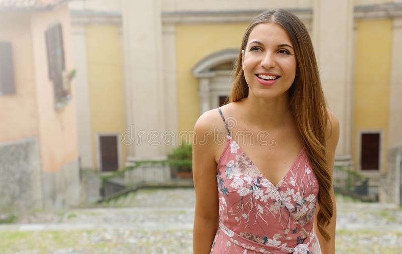 Beautiful girl climbs street in old Italian town. Copy space area royalty free stock image
