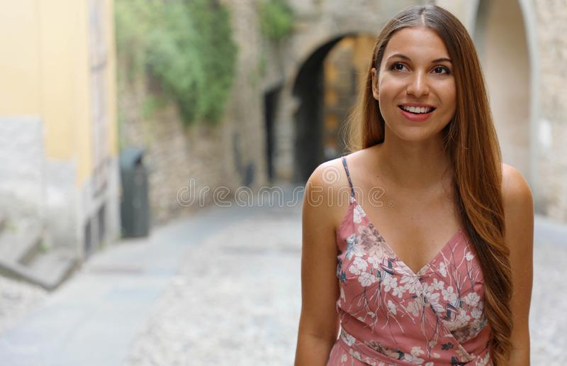 Beautiful girl climbs street in old Italian town. Copy space area royalty free stock photography