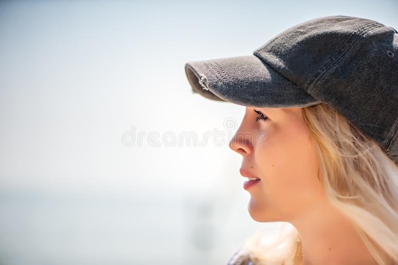 Beautiful girl close-up in profile royalty free stock photography