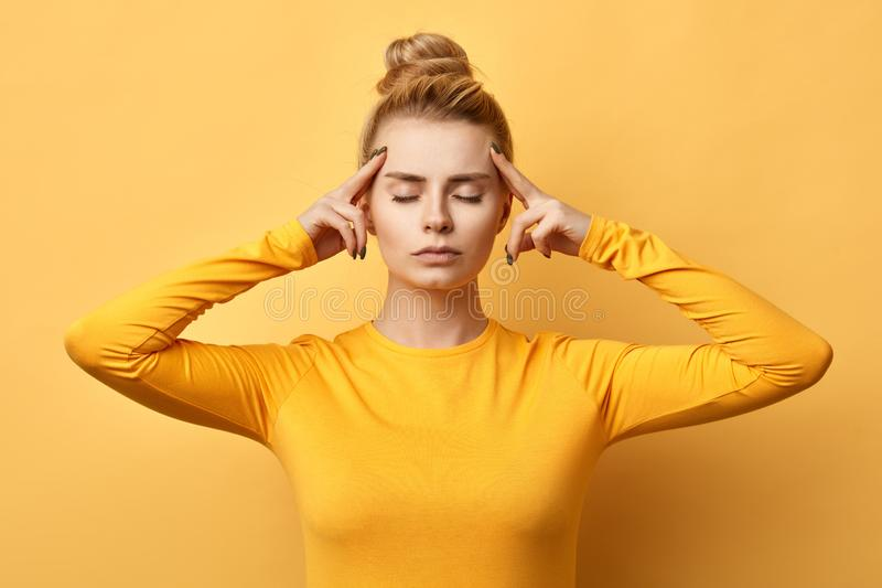 Beautiful girl with closed eyes concentrated on idea stock image
