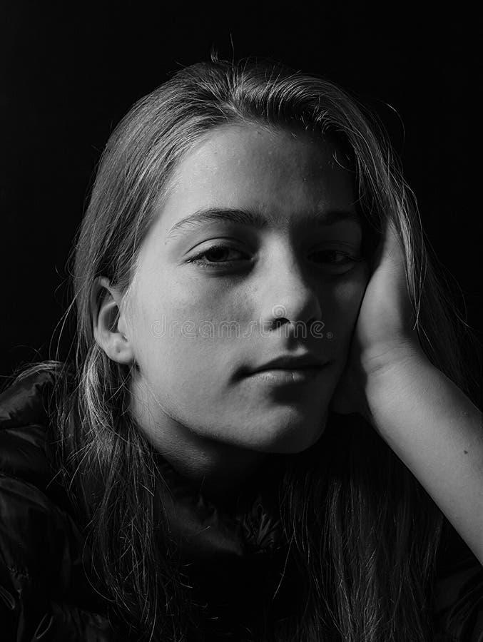 Beautiful girl closeup B&W low-key portrait stock photo