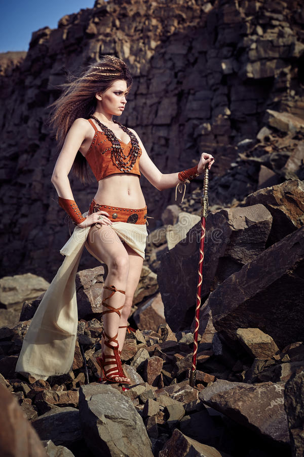Beautiful girl in the clothes of a Viking or Amazon. stock images