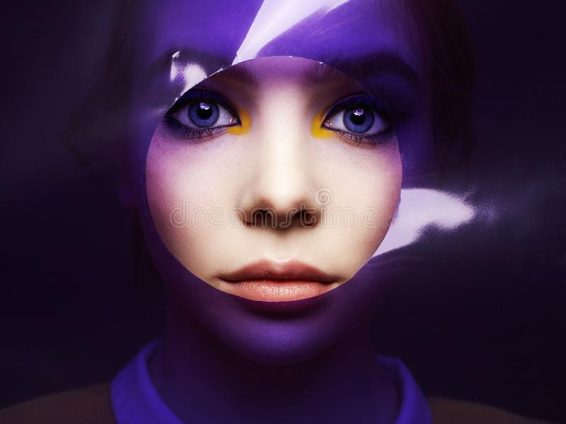 Beautiful girl with color make-up into colorful film. Female face art portrait royalty free stock images