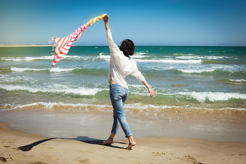 Download Beautiful Girl With Colorful Scarf On The Beach Stock Photo - Image: 83723586