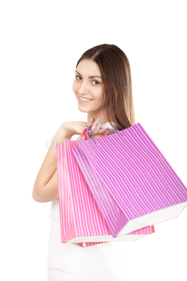Beautiful girl with colorful shopping bags. Portrait of smiling female holding colorful shopping bags, isolated on white background. Concepts: sales, rest stock photo