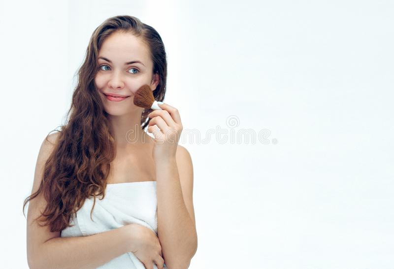 Beautiful girl with cosmetic powder brush for make up. Makeup. Make-up applying  for perfect skin.  stock images