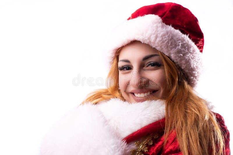 Beautiful girl in costume of Santa Claus royalty free stock photos