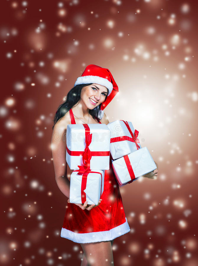 Beautiful girl in costume of Santa Claus with shopping royalty free stock image
