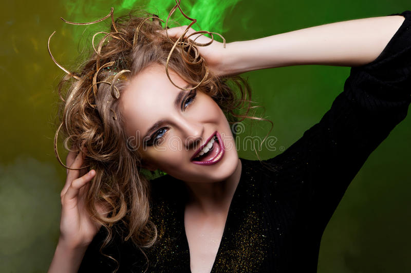 Beautiful girl with creative hairstyle. Beautiful happy young woman with creative hairstyle. Color light. Emotion stock photo