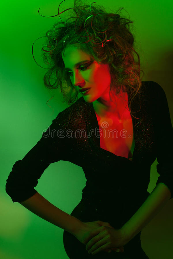 Beautiful girl with creative hairstyle. Beautiful young woman with creative hairstyle. Color light stock images