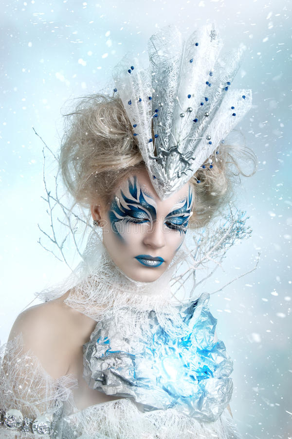 Beautiful girl with creative make-up for the new year. Winter portrait. stock photos