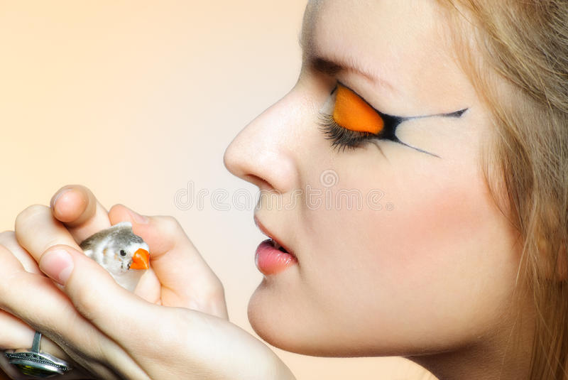 Download Beautiful Girl With Creative Makeup And Bird Stock Photo - Image of markings, beauty: 29276998