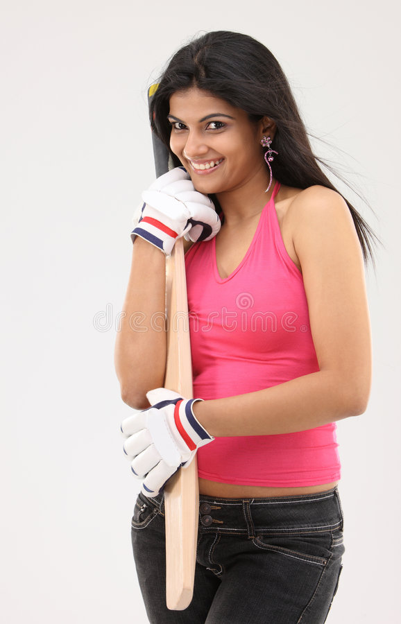 Beautiful girl with cricket bat. And gloves royalty free stock photo