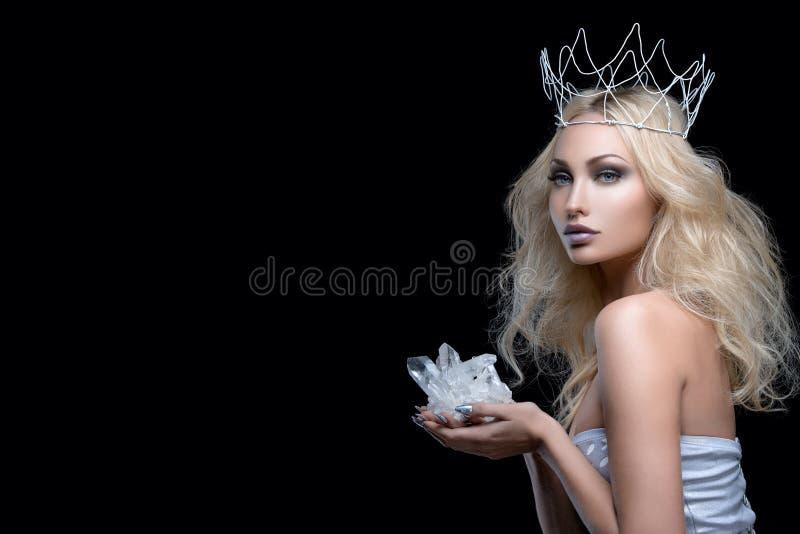 Beautiful girl crown holding crystal stock photos