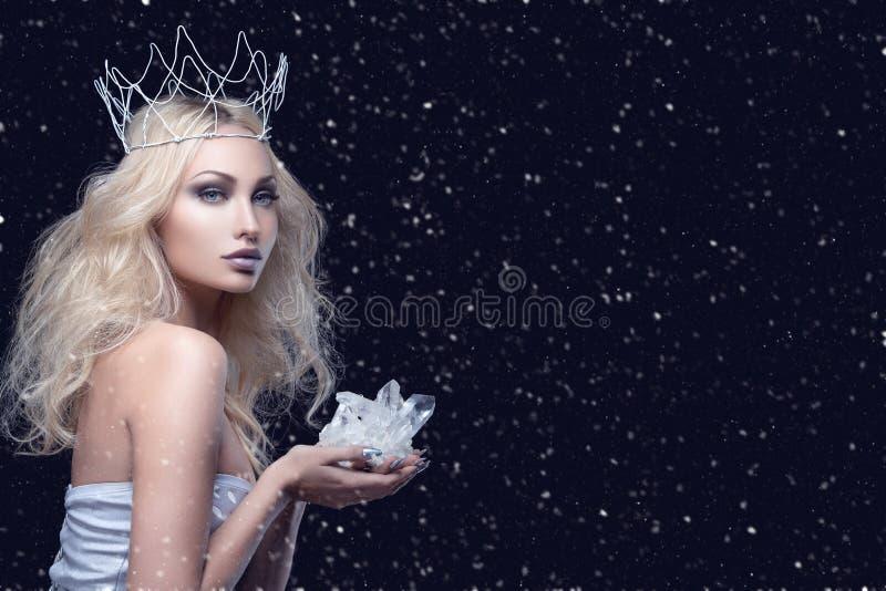Beautiful girl crown holding crystal stock photo