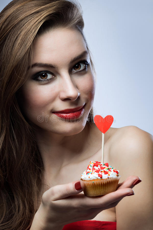 Beautiful girl with a cupcake royalty free stock photo