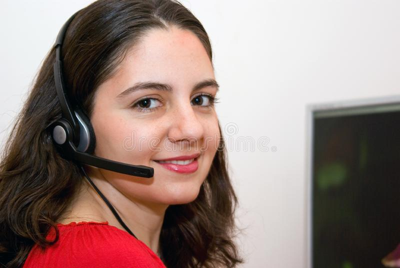 Beautiful girl customer service with microphone stock photo