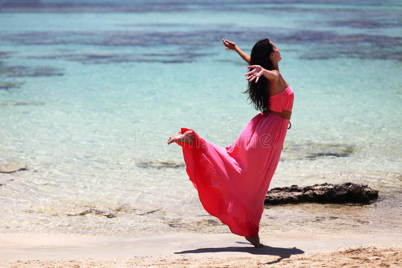 Beautiful girl dancing on the beach stock images