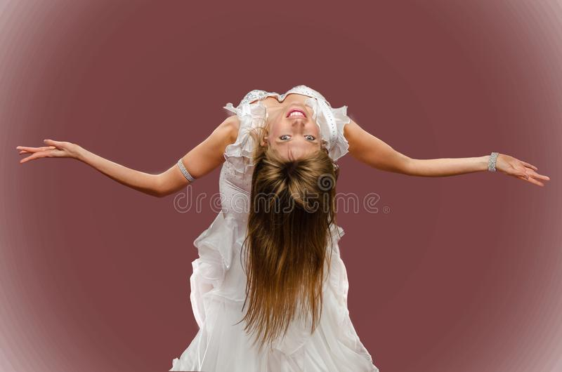 Beautiful girl dancing belly dance on red background. stock photo