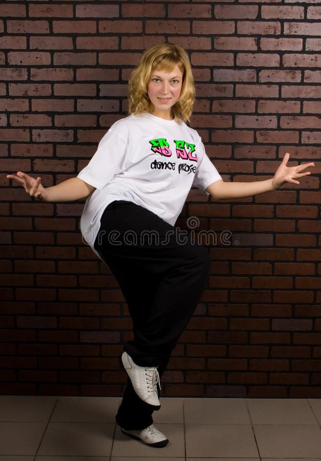 Beautiful girl dancing hip-hop stock image
